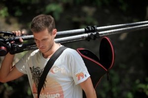James(cameraman)_carrying tripod through jungle