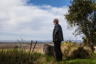 Fisherman, Sean Burke, looking over his fence at Batemans Marine Park © Danielle Ryan Sept/Aug 2014