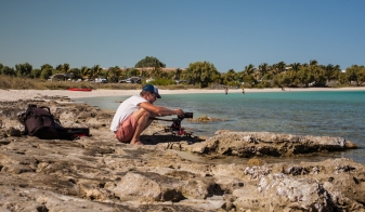 Cameraman, James Sherwood, filming at Coral Bay, edge of Ningaloo Reef Marine Park © Danielle Ryan - Bluebottle Films