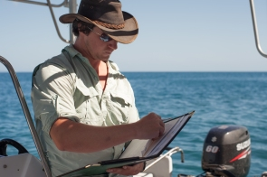 James Cook University researcher near Orpheus Island, Great Barrier Reef Marine Park © Danielle Ryan - Bluebottle Films